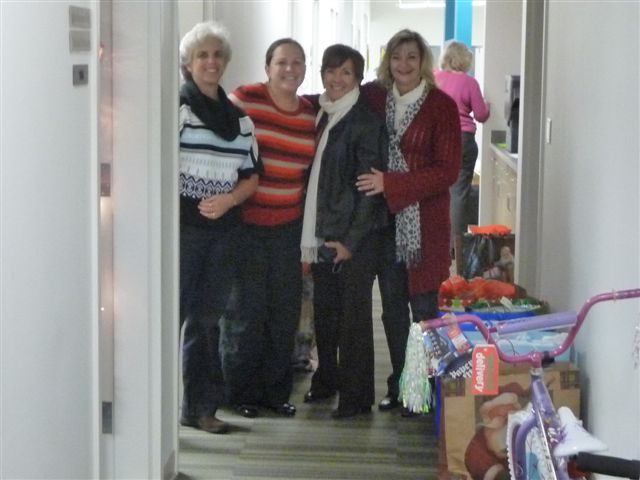 """Catawba Nuclear Station """"elves"""" collecting gifts to donate to the Department of Social Services care in York County Adopt a Child program."""
