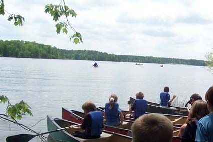 Group canoeing on Harris Lake