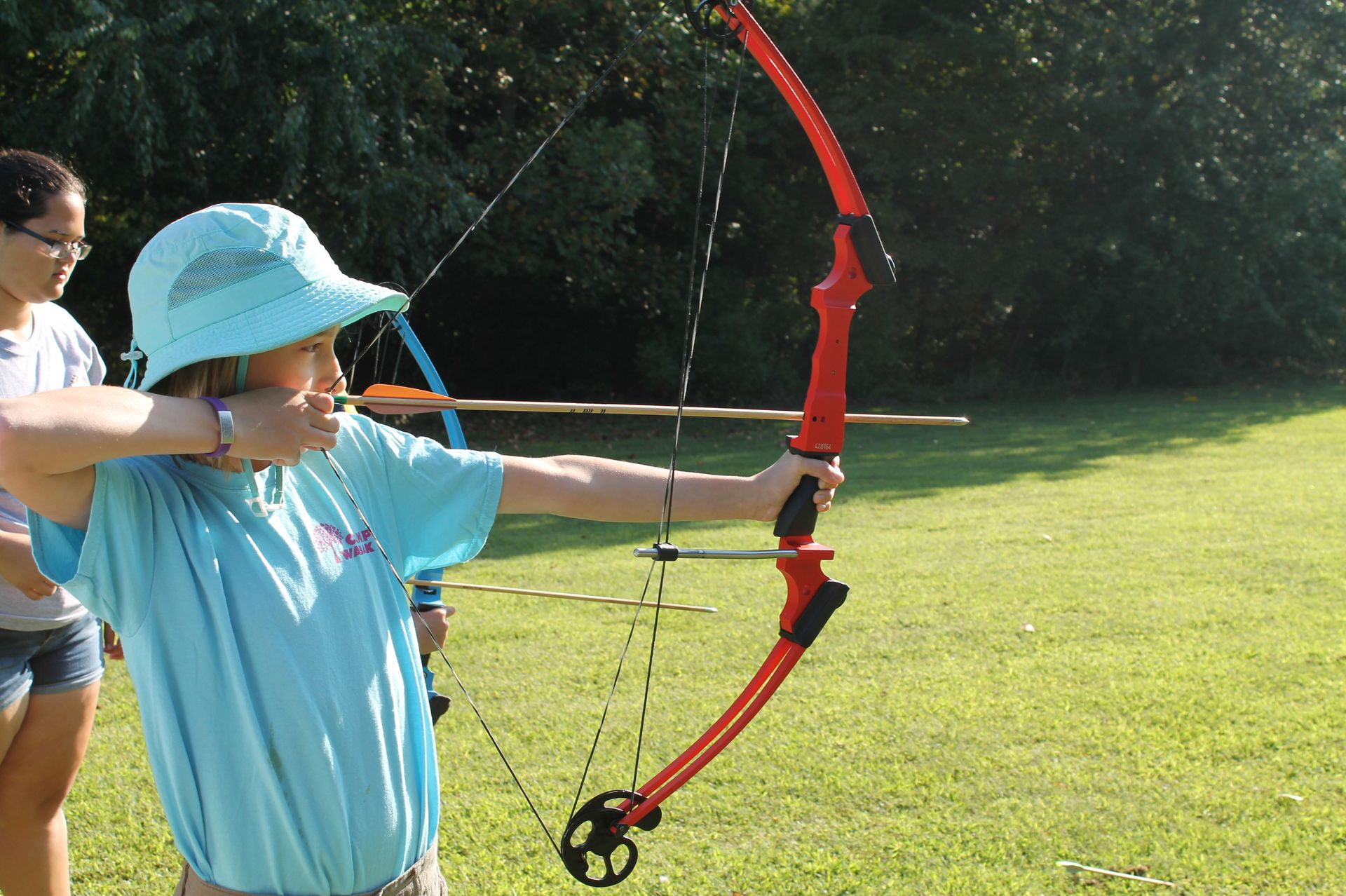 Students learning new skills at Hunting and Fishing Day