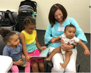 "BabyRead volunteer, Martha Clardy, and her ""clients"""
