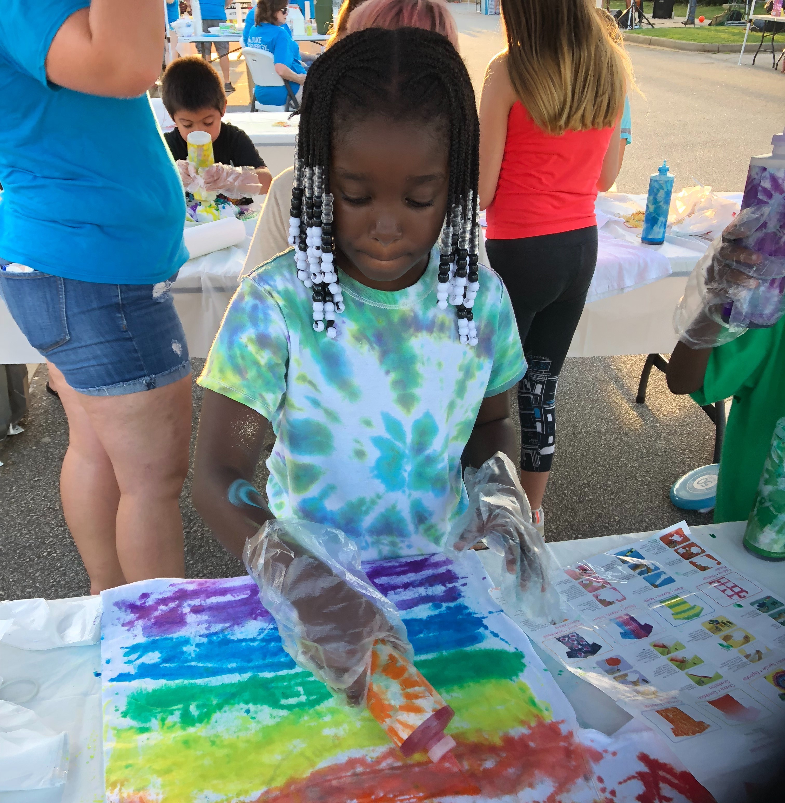 Tie-dying shirts at Duke Energy Night in Walhalla, S.C.