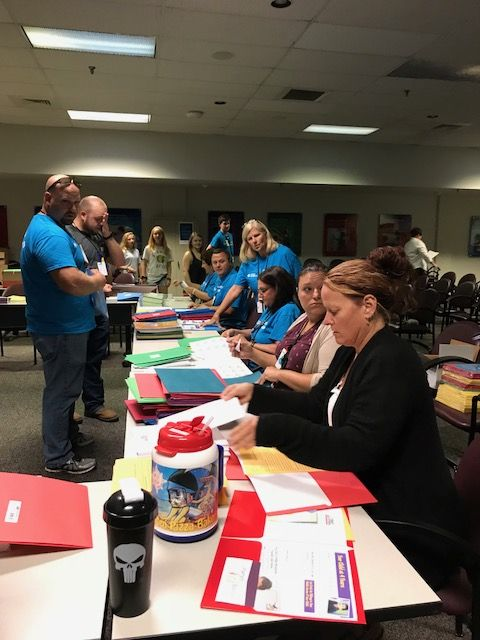 Oconee Nuclear Station employees stuffing backpacks for the School District of Oconee County
