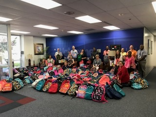 Robinson employees donating more than 760 backpacks to over 20 local schools