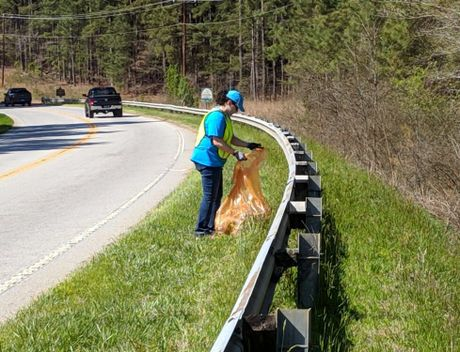 Oconee Nuclear Station volunteer picks up litter as part of KOBA's Adopt-A-Spot