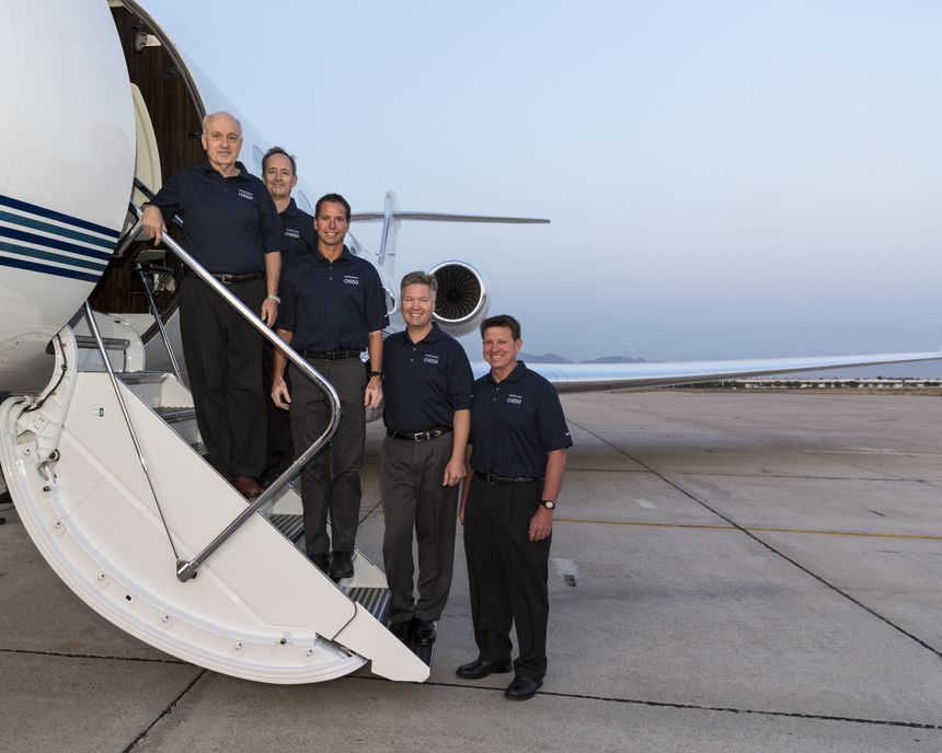 The Gulfstream flight crew for the G650's around-the-world record. From left: Tom Horne, Bud Ball, Eric Parker, Ross Oetjen and John McGrath.