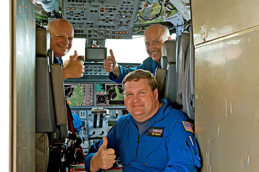 Members of the G650 flight-test crew celebrate achieving Mach 0.995