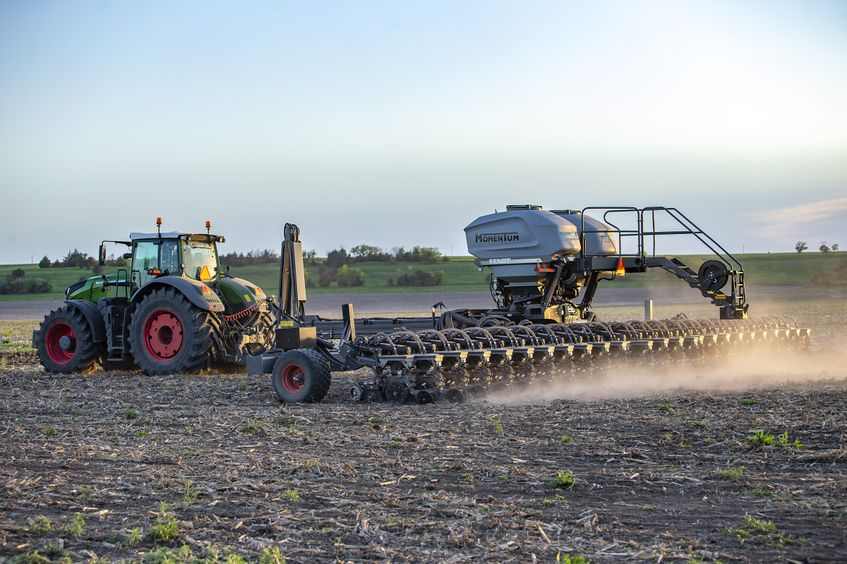 Momentum planter being towed by Fendt tractor
