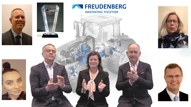 Collage of smiling headshots surrounding illustrated tractor backdrop and three people in suits clapping mirthfully; award superimposed