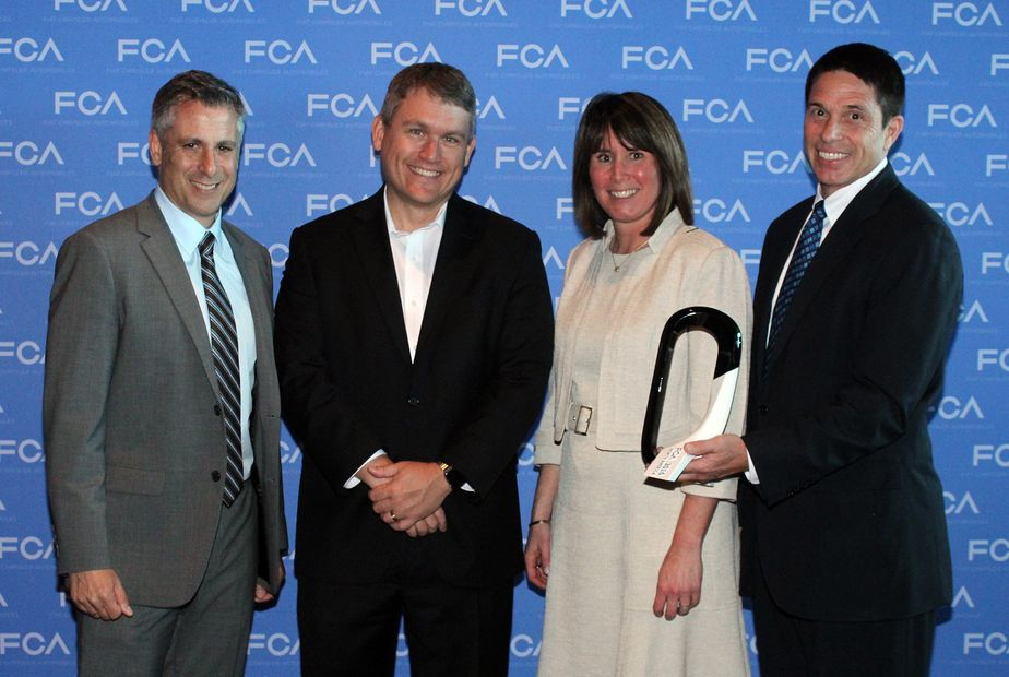 Xerox Accepting Services Quality Supplier Award from FCA US