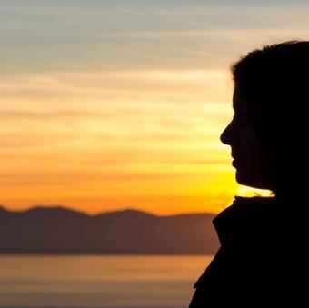 A688~woman-sunset_16x9