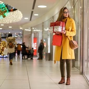 Woman enjoying Christmas shopping at the mall