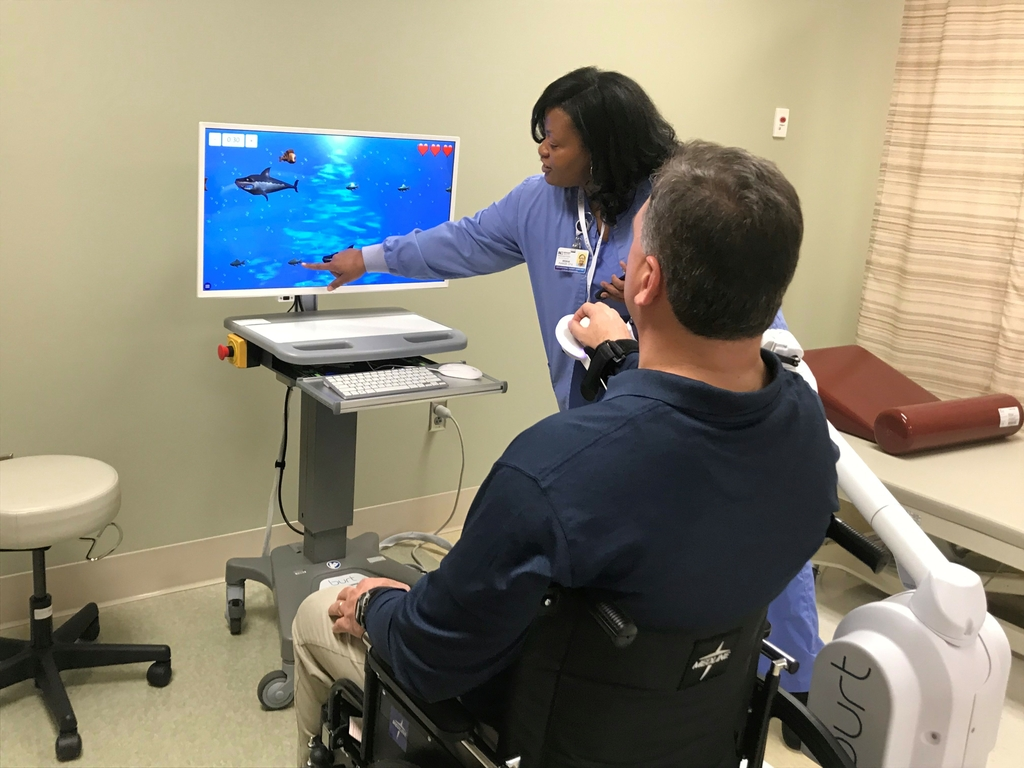 Video games and robots are new tools in speeding patient recovery