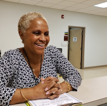 Milagros Amaro shares a laugh at the Guilford County Health Department