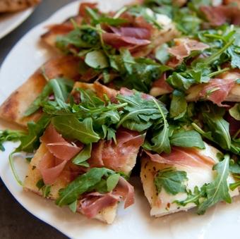 Close-Up Of Fresh Flatbread Prosciutto Pizza Served In Plate