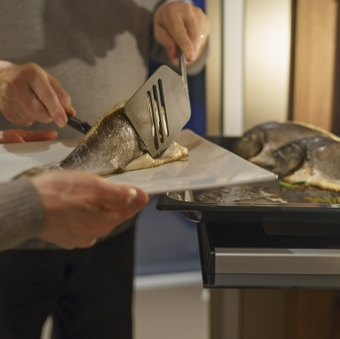 Preparing gilthead seabream, from the oven