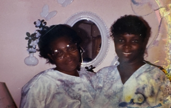 Joyce McNeill with her mother Ornetha take a picture together after church wearing the same dress