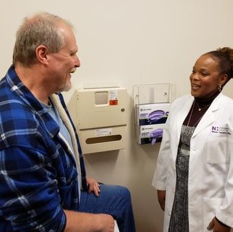Dr. Mishi Jackson with patient