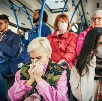 Woman with fever and flue traveling by public transport