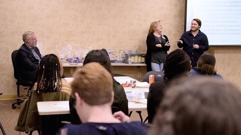 Dr. Rhett Brown, Kristen and Leo address group from Novant Health WomanCare.