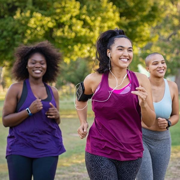 Active curvy women jogging
