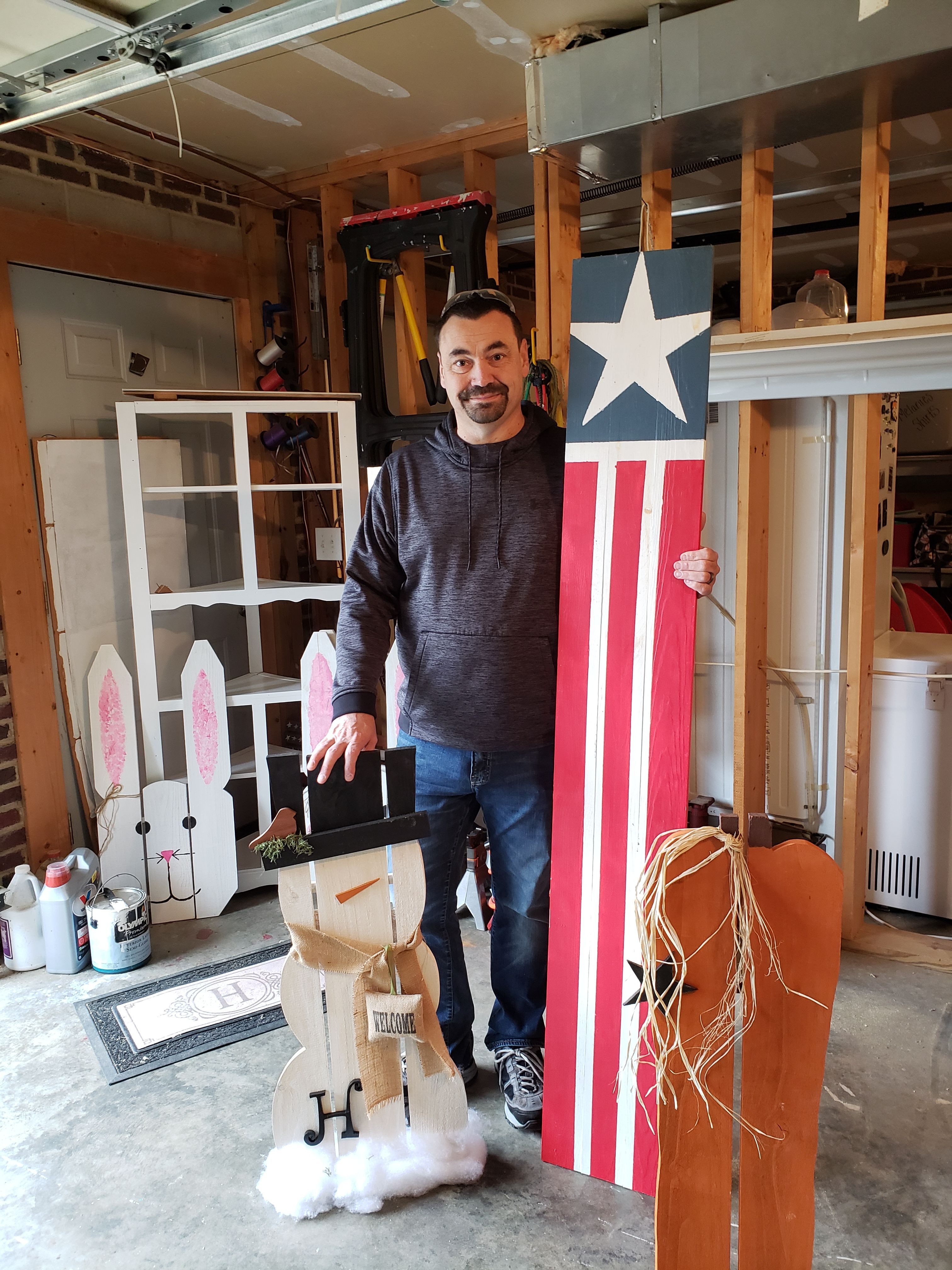 John Hepler with a few of his woodworking projects.