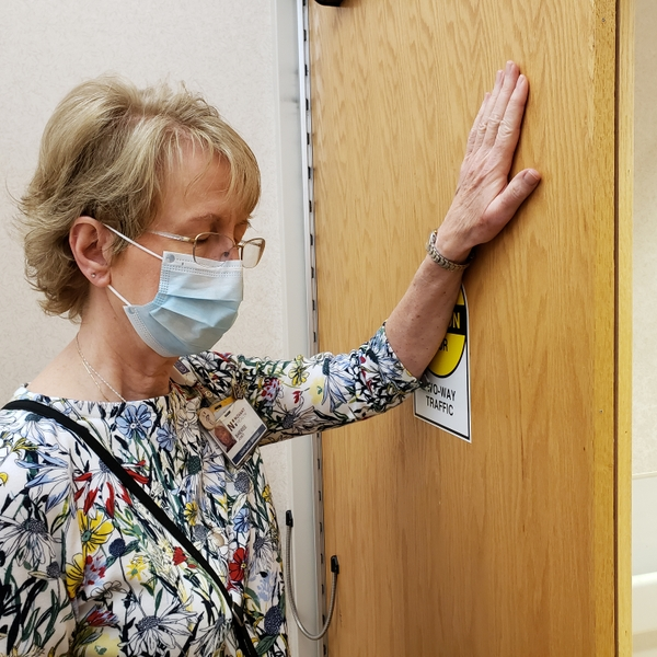 Sheree Jones prays outside the COVID-19 unit