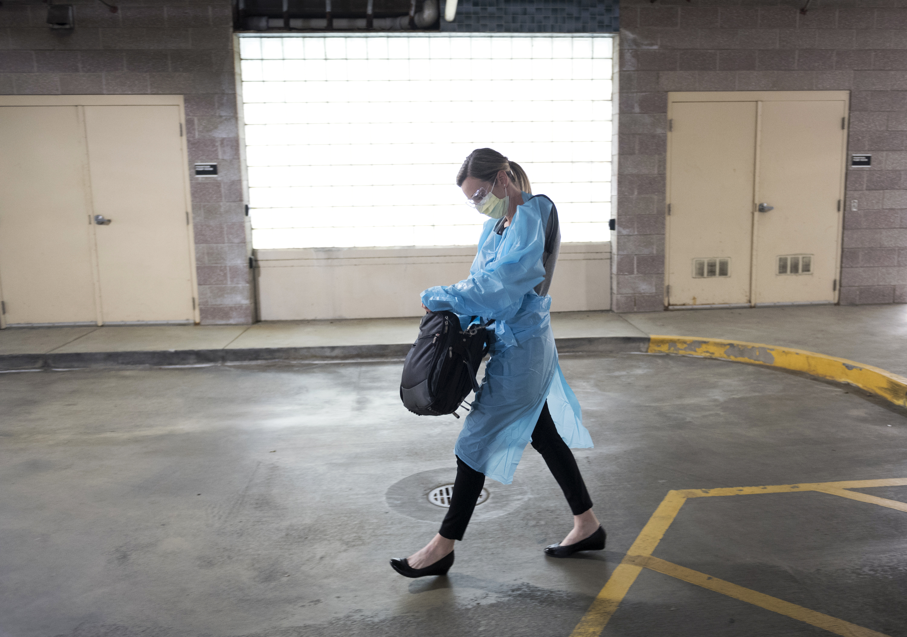 A Novant Health provider walks out to the parking lot for a sick visit.