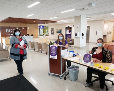 Left to right - Jamie Vogler Akemi Raish and Sidney Yates staff the guest services table at Novant Health Clemmons Medical Center