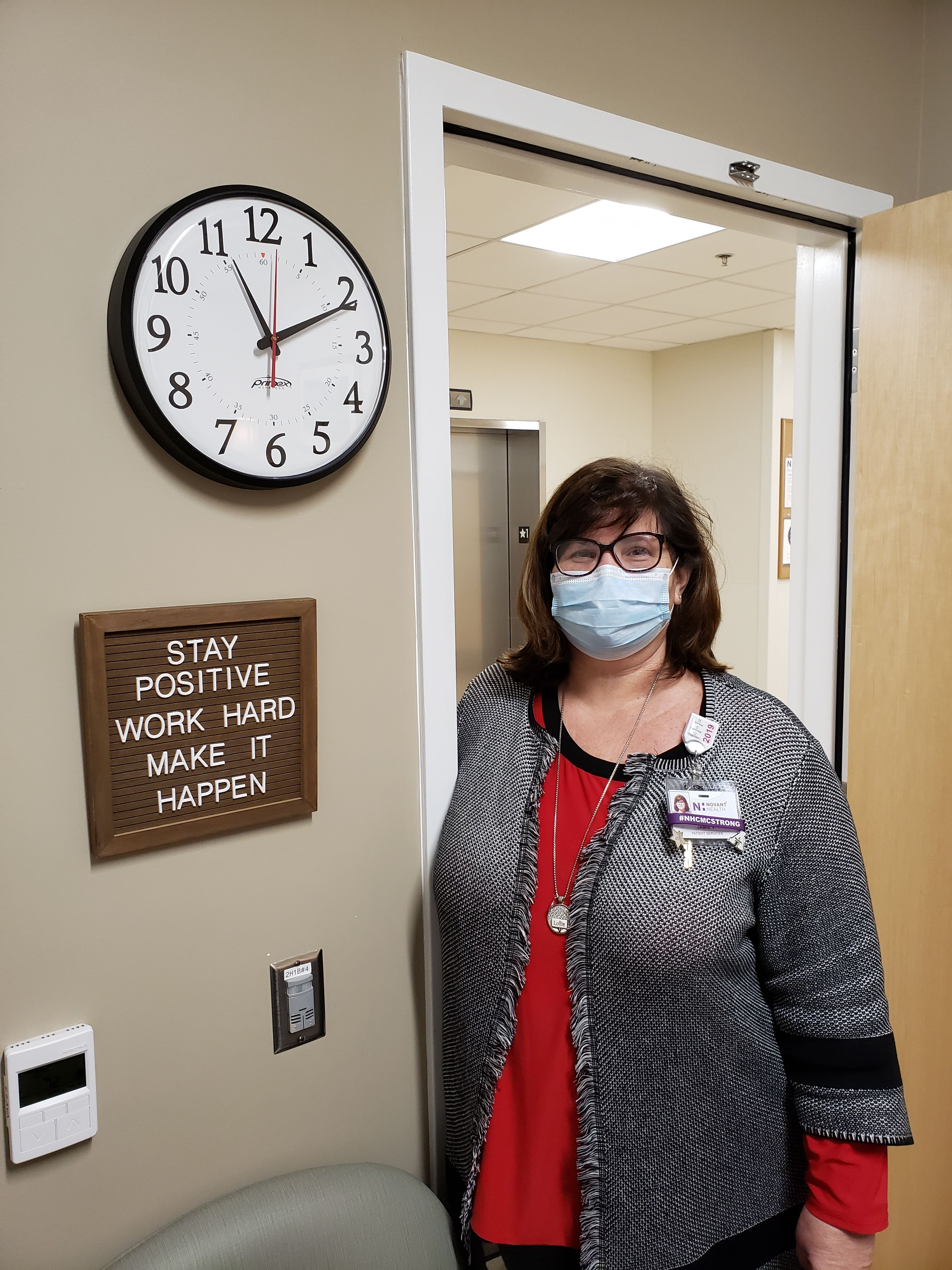 Jamie Vogler with her office sign