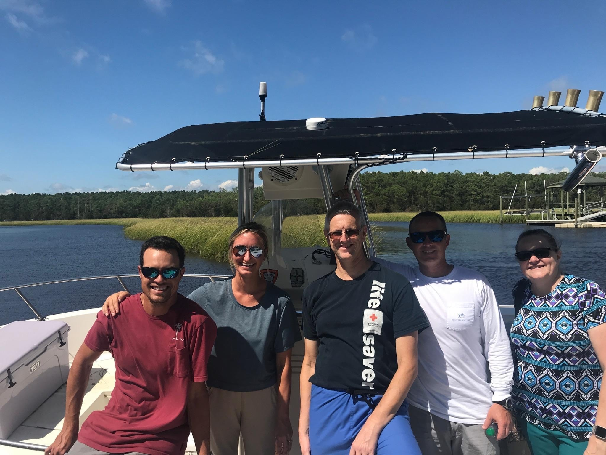 Dr. Mason and fellow team members take boat to work due to hurricane flooding.