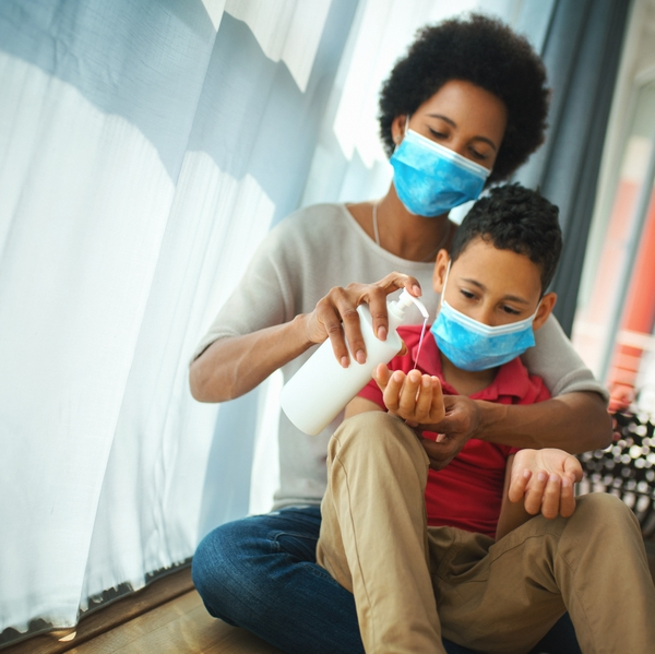 Mother and son wear masks to stay safe