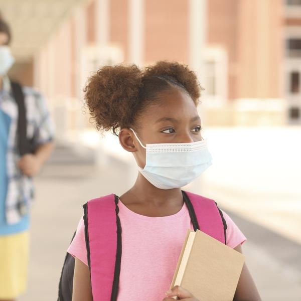 Mask-wearing kids go to school