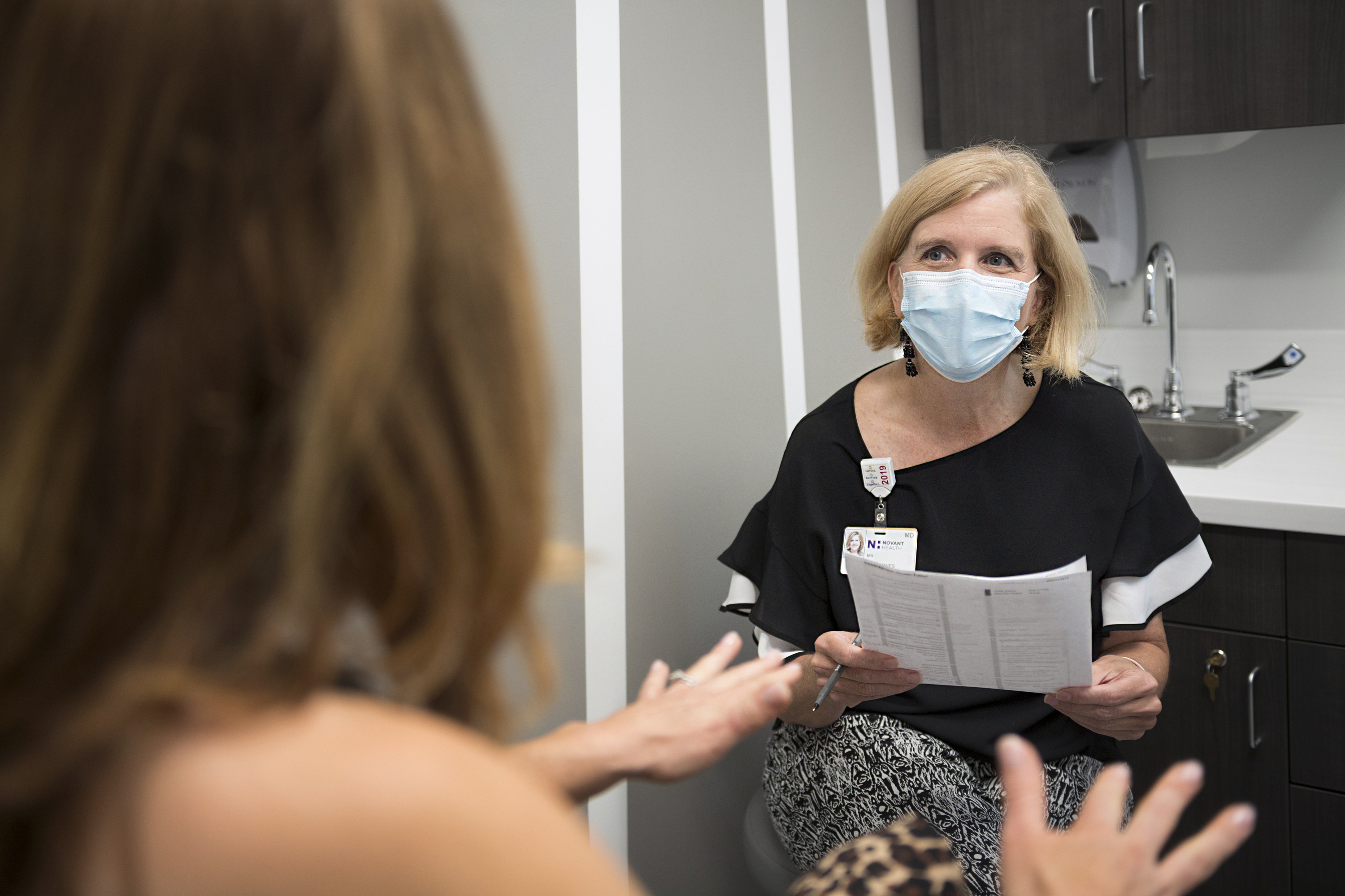 Dr. Alyse Kelly-Jones talks with a patient at the Novant Health Women's Center.