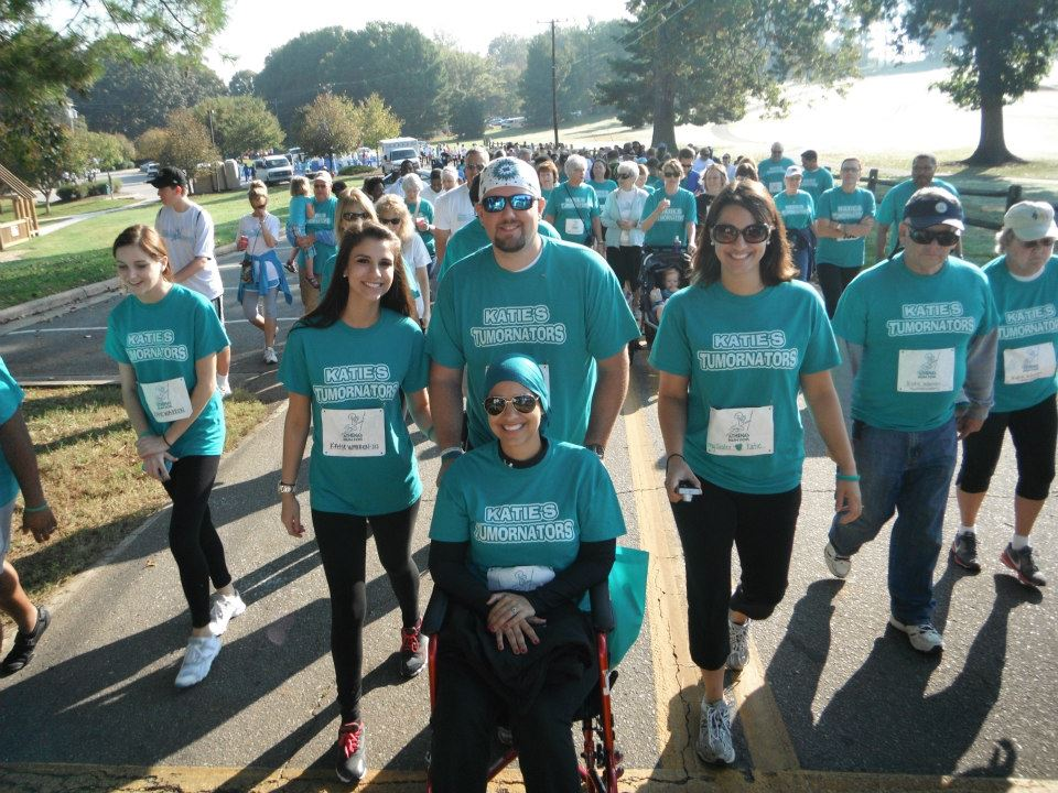 Katie Warren is pictured with supportive family and friends at a previous Athena's Run for GYN Cancers.