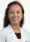 Dr. Elizabeth Skinner in a white coat