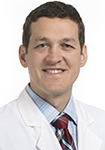 Dr. Joseph Malek, a urogynecologist at Novant Health, is pictured in a white coat.