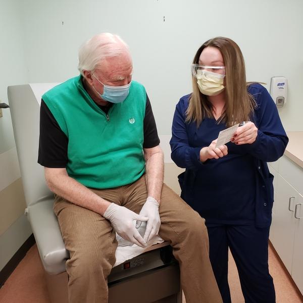 Phillip Wooten receives vaccine card