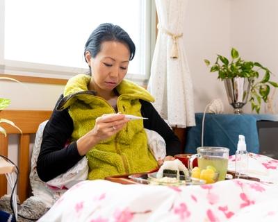woman sick at home