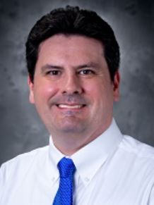 Dr. Christopher Pizzola smiles