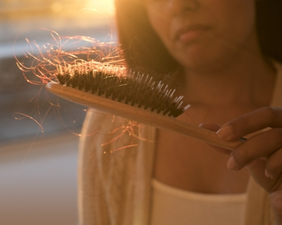 What causes hair loss in women and what you can do about it