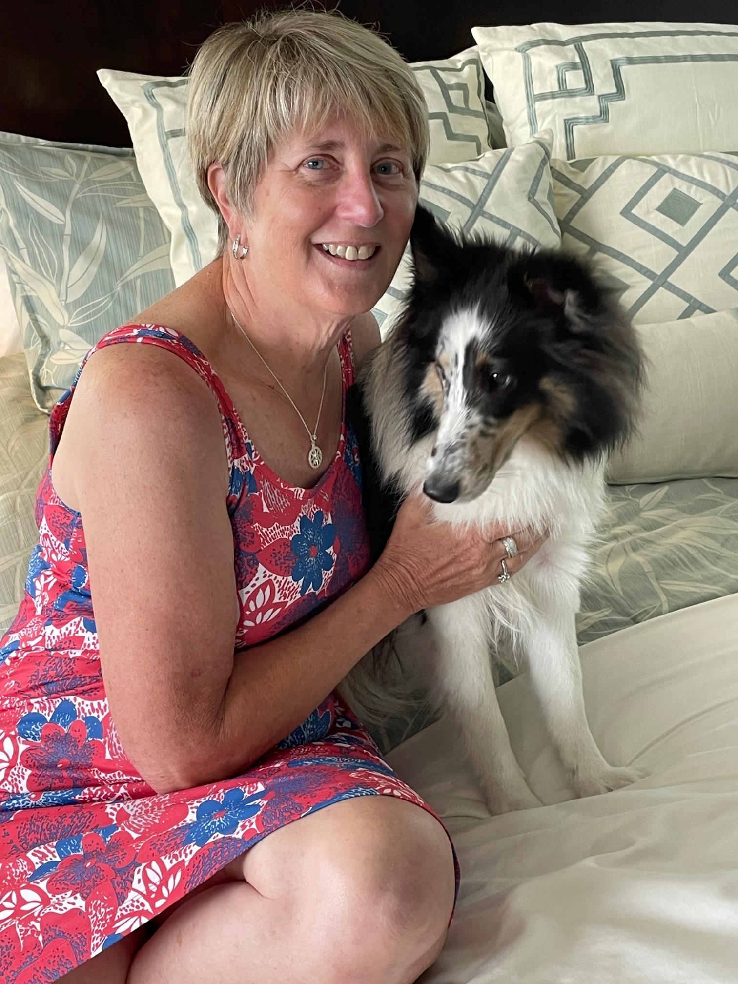 """Margie """"Kay"""" Pope, 64, smiles with her 1-year-old Sheltie puppy."""