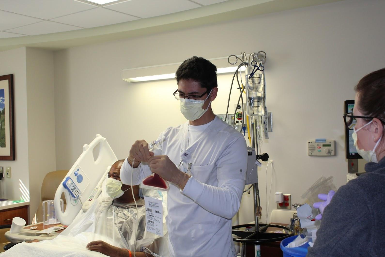 A Novant Health team member holds a bag of Covington's stem cells.