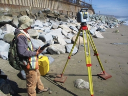 A member of the land survey crew gathers data for topographic land surveys.