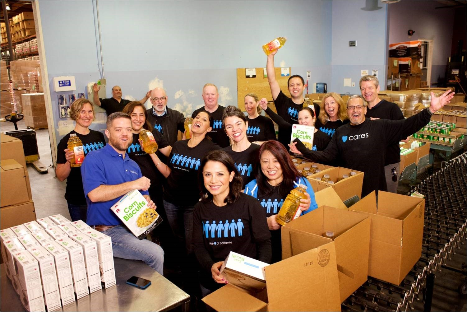 Blue Shield's Chief Health Officer, Dr. Marcus Thygeson, and employees volunteering at San Francisco and Marin Food Bank