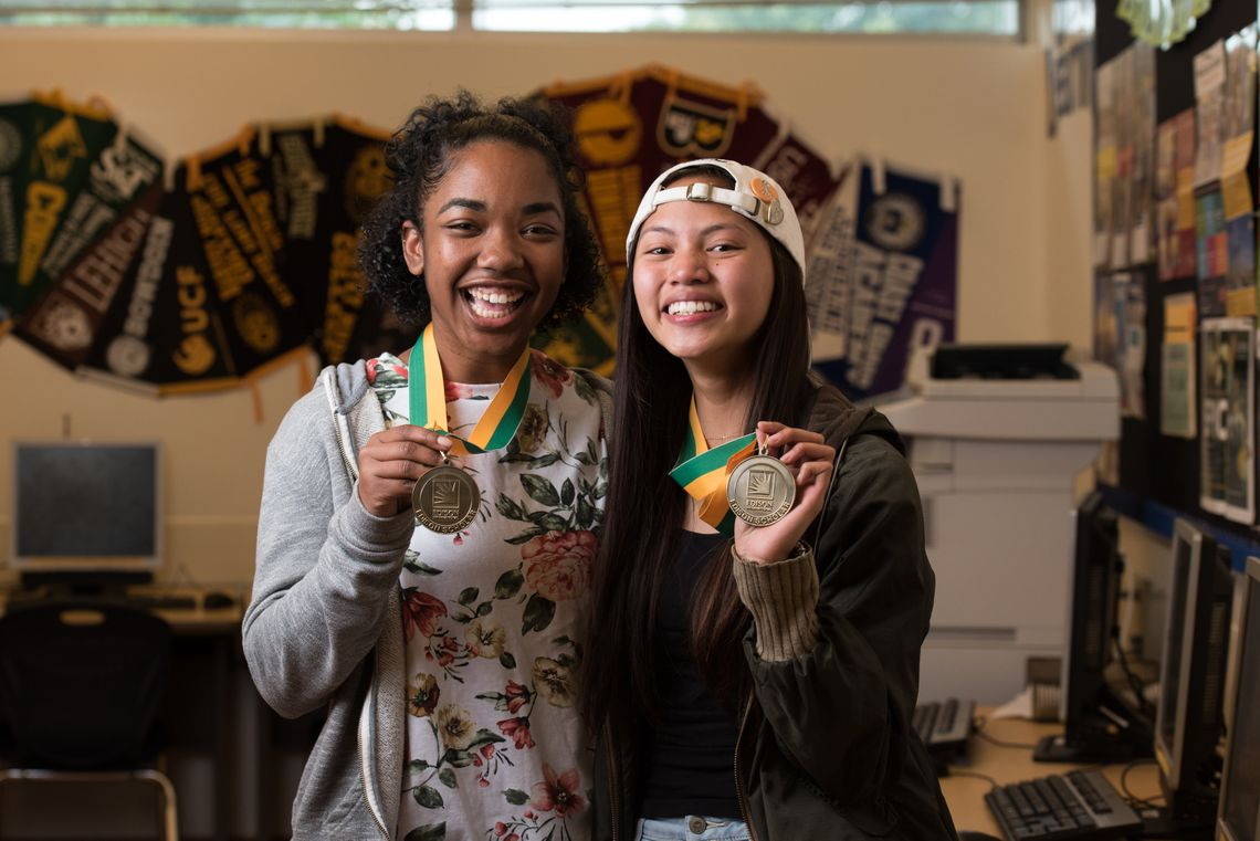 Best friends Shavonna Jackson (left) and Avey Songco, seniors at the California Academy of Mathematics and Science in Carson, pose with their Edison Scholar medals.