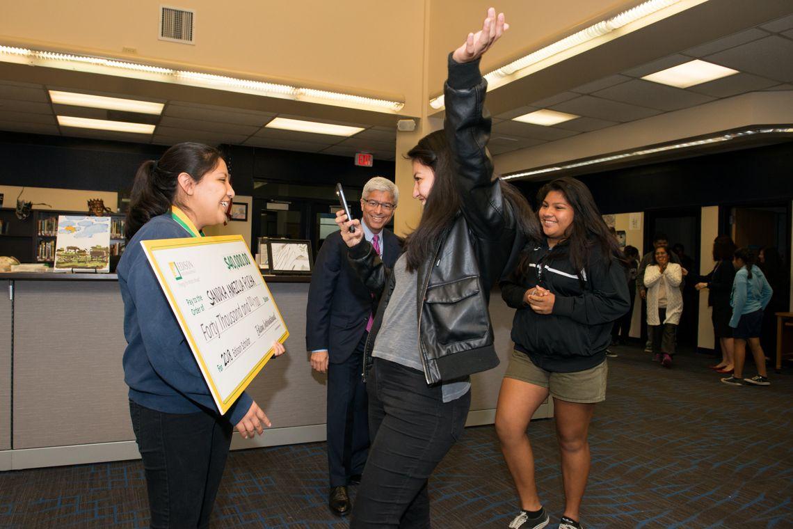 Edison Scholar Sandra Amezcua Rocha is congratulated by her sister Isaura.