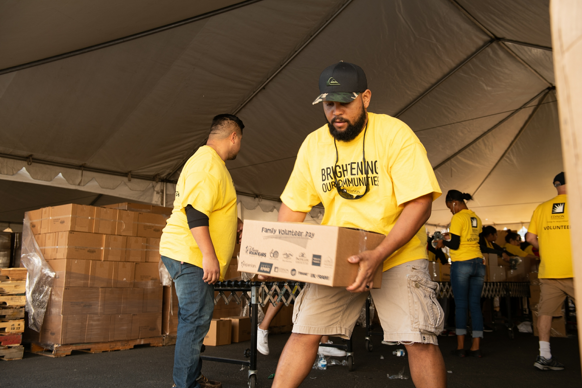 Rob Vernon, an SCE planner, moves one of the 6,080 food box Edison employees packed.