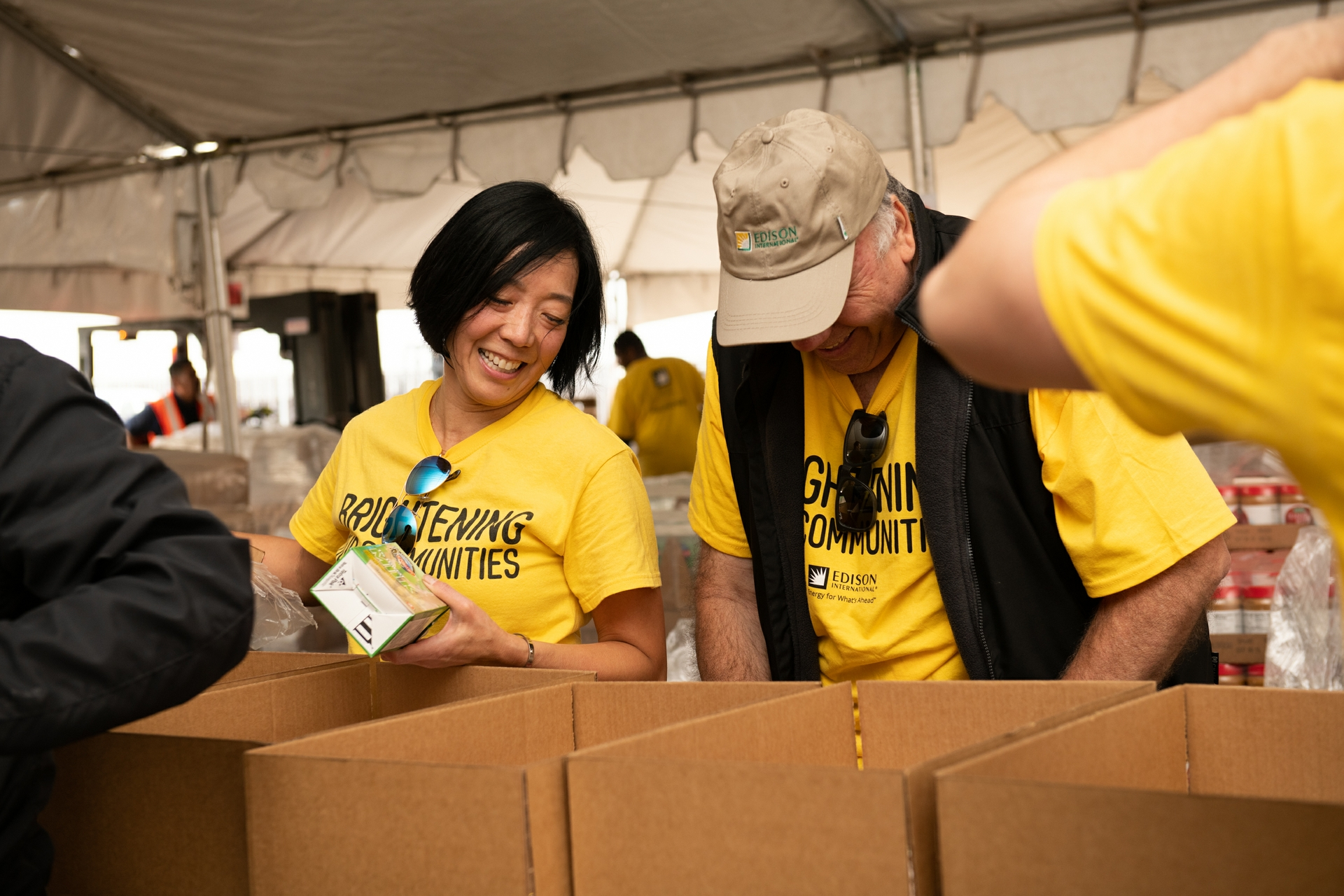 Caroline Choi, SCE senior vice president of Regulatory Affairs, packs boxes of dried milk at an OC Food Bank event.