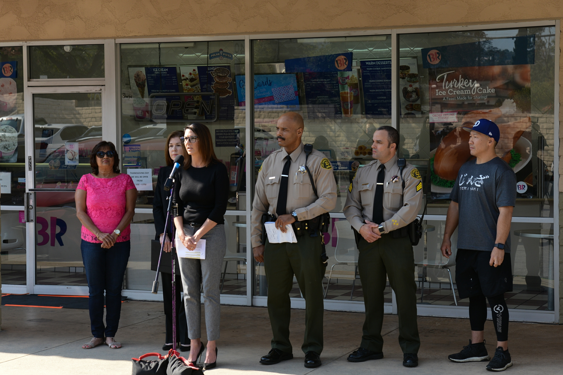 Edison's Consumer Affairs manager Kari Gardner, third from left, warns SCE customers and the general public to stay alert this holiday season when utility phone scams increase. Joining her left to right: Jyotsna Maru, Baskin-Robbins shop owner; Stephanie Orrick, FBI; detective Wayne Countryman, L.A. County Sheriff's Industry Station, an L.A. County Sheriff's associate; and John Lee, owner of Jinza Teriyaki in Pomona.