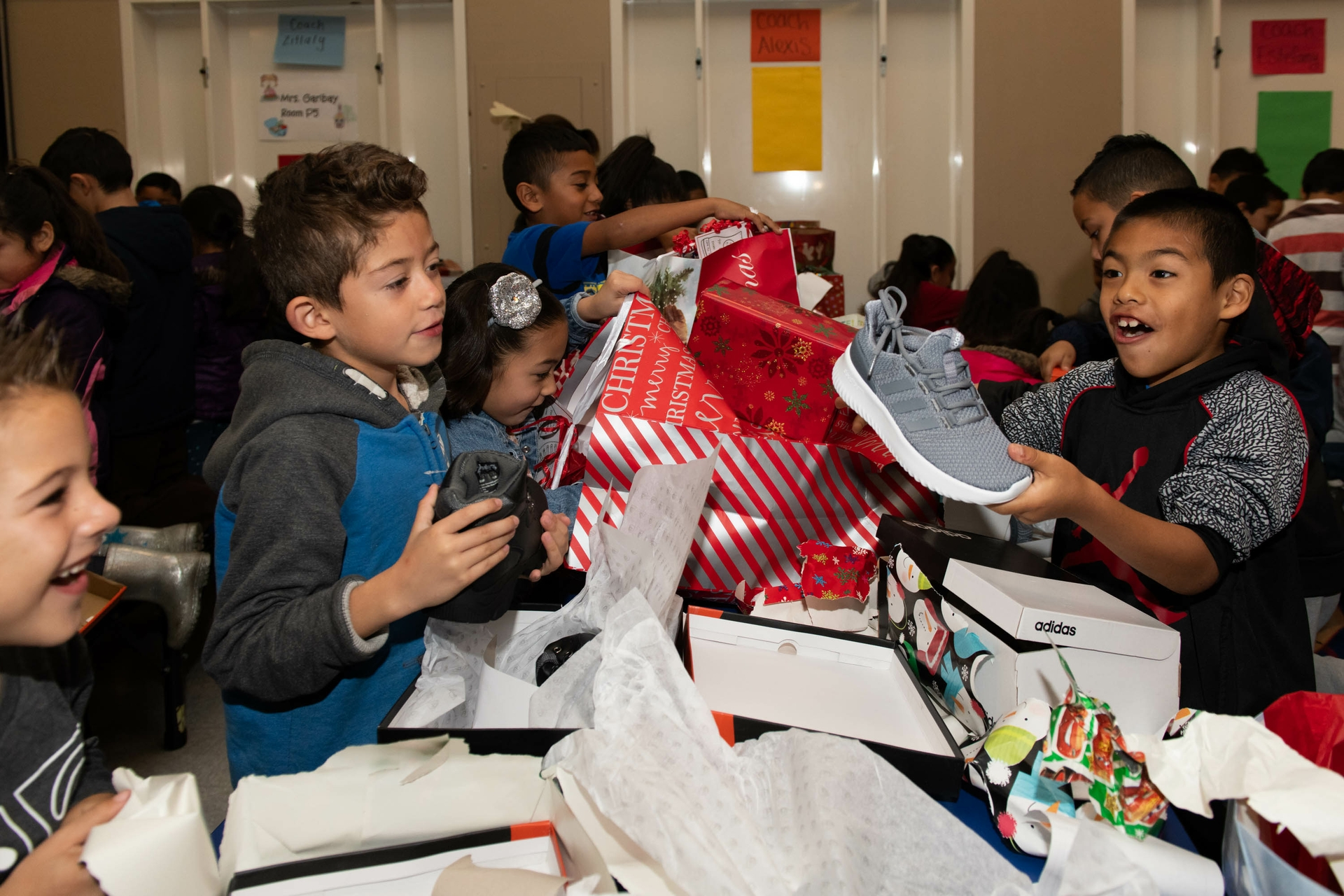 Edison employees partner with nonprofit Shoes That Fit and donate shoes to kids in need.